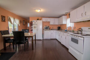 33 Acres of hardwood with a mobile mini on 1.2 Acres