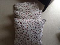 4 X feather filled cushions.