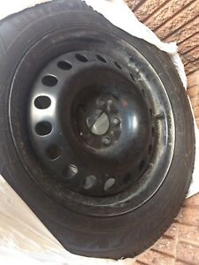 Four brand new 225/R0617 winter tires and rims