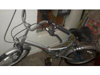 CHALLENGE FOLDING BICYCLE WITH SIX MICROSHIFT GEARS IN GOOD CONDITION.