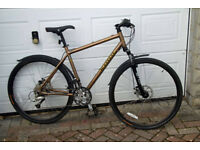 As New KONA DEW FS. 18in bronze frame. 24 speed. Disc brakes. Fork & Seat suspension