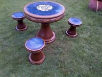 beautiful glazed terracotta garden or patio table and three stools set can deliver
