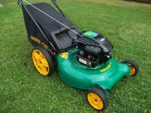**BEAT THE TAXES** PREMIUM, ROCK SOLID BAGGER MOWER