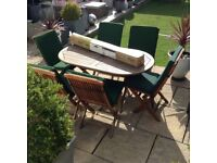 Quality teak garden patio table, 6 chairs with seat cushions and parasol £150 Ono tel 07966921804
