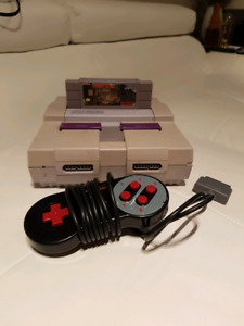 Snes (power & av cables included) with controller and game