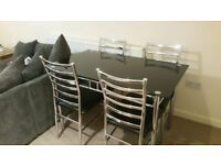 Black Glass Top Table and 4 Chairs