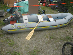 Estate Sale 14 ft/ 12 ft inflatable boat and motor