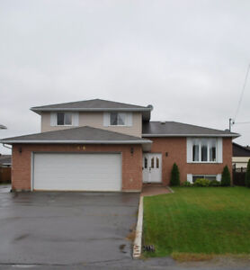 PRICE REDUCED!! Do you need two large garages, and a deep lot?