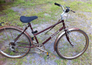 Vintage Raleigh riding bicycle