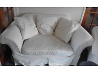 Free. Cream two seater sofa and armchair