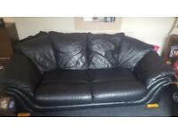2 black leather settees