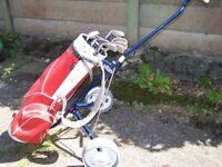 Carobs Golf Bag on Turfglider Trolley by Titleist with Seven Clubs and Two Putters