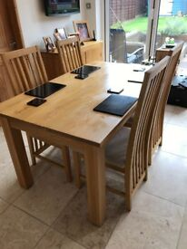 Solid wooden table with four high back chsirs