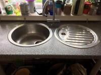 Twin bowl stainless steel. With taps.