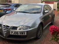 Grey Alfa Romeo GT. No MOT. Lovely car, leather seats.