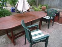 HIGH QUALITY EXTENDING TEAK TABLE, UMBRELLA, 6 COMFORTABLE CHAIRS WITH CUSHIONS