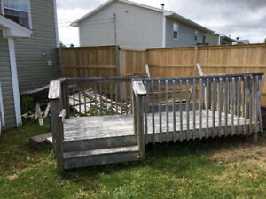 6 year old deck and a pile of old fence lumber