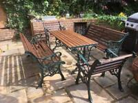 Cast iron patio bench and table set