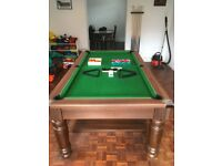 For sale is a 7ft snooker/ pool table with traditional wooden knurled legs and body in oak.