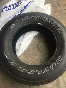 Set Of Bridgestone Tires And Spare