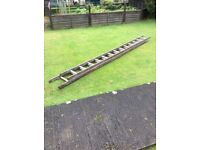 12 foot extendable wooden ladders £25. Good condition