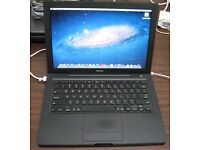 Macbook Black edition Apple laptop with 500gb hard drive fully working