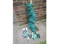 Flexible coil garden hose 30 metres. Plus a number of accessories.