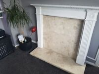 granite fireplace with wooden surround