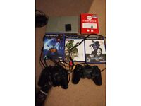 Sony playstation 2 ps2 with tekken 5, metal gear solid 3, soul calibur 2 and 2 pads