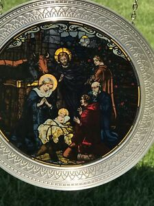 Stained glass and pewter nativity scenes
