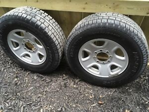 A set of 4 Winter tires and rims. 275/70/18. Dodge factory rims