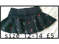Miniskirt sz 12, black with card suits - clubs, hearts