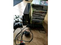 Xbox 360, Kinect, 3 remotes, charging doc (brand new), over 30games