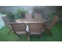 Wooden outdoor table and 6 chairs set