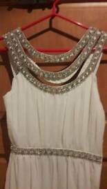 Stunning white floor lengh dress. Brand new. Tags on.