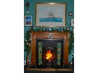 Pine mantle piece and ornamental tiled victorian fir grate