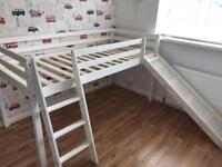 Mid sleeper bed with slide