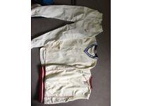 set of Nike cricket trousers, long sleeve and no sleeved jumpers.