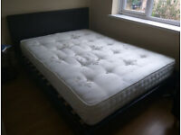 Kingsize Bed (dark brown) plus a good class double size matress (medium hardness) good condition