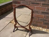 An attractive dressing table mirror.