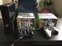 Black 250GB XBox 360 bundle with 4 controllers and 29 games