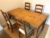 Wooden dining table and 4 chairs for sale, good condition