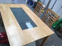 Solid wooden table with glass insert
