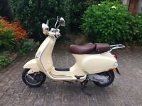 Classic Cream Vespa (2008) with leather seat, only 8000 miles on the clock!
