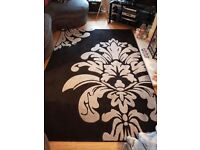 Black and grey rug.size 160x230.immaculate condition £30.no timewasters please