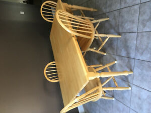 Solid honey oak dining table and 4 matching chairs.