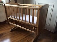Wooden crib with mattress in very good condition
