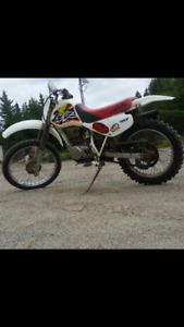 2 Honda xr 100 dirt bikes. Both need motor work