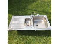 Stainless steel kitchen sink and mixer taps