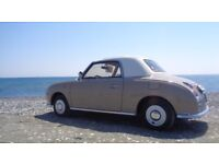 Nissan Figaro in LEFT Hand Drive totally refurbished to immaculate condition. Worldwide shipping.